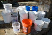 A number of buckets wait to be used for the test.