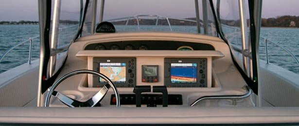 The cockpit of a center console shows twin displays for radar and GPS