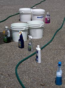 A few buckets, a hose and some detergents wait to be used.
