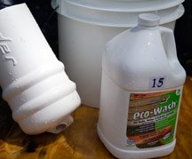 A clean boat fender sits next to ConcrobiumXT eco-wash in a bucket.