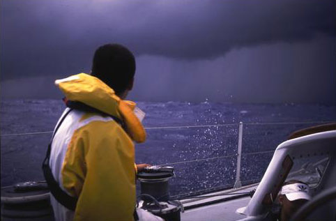 A sailor searches the horizon and realizes he is in for a blow.