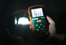 A yellow colored light meter is used to test the luminosity of a white stern light.