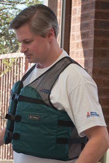 A man wears the Onyx fishing vest.