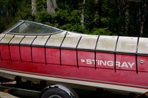 A red stingray powerboat is sectioned off by tape in preparation for the test.