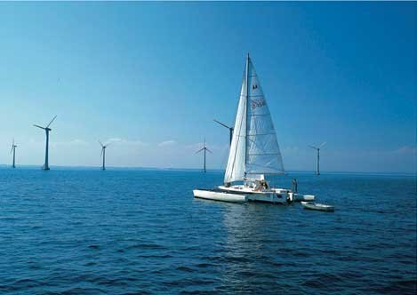 Photo of a wind farm at sea
