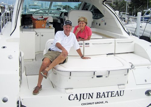 Photo of Former Senator John Breaux and his wife aboard their 47-foot Sea Ray