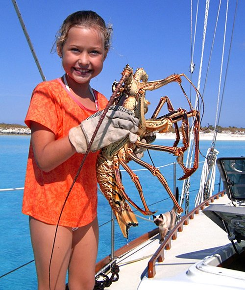 Photo of Oliva holding a spiny lobster