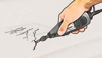 Illustration of Grinding out the cracked surfaces with a dremel