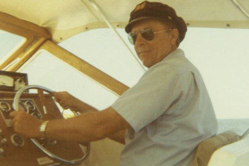 Photo of Jim West at the wheel of his third Lyman, a 23-Offshore