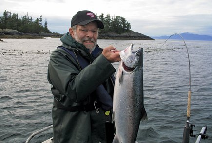Ryck Lydecker displays the coho he's caught