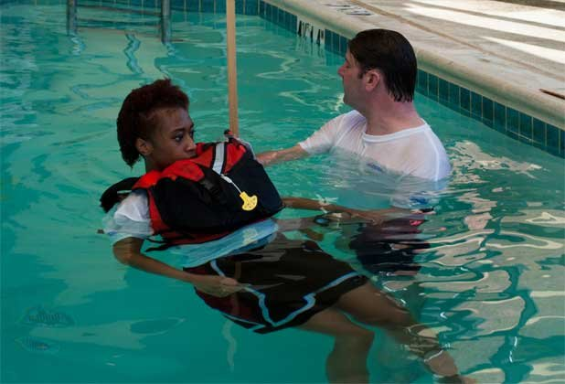 Photo of a life jacket test with user floating upright