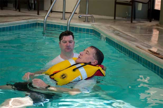 Photo of a life jacket test with subject floating