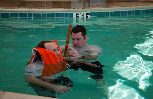 Photo of a life jacket test submerging the jacket underwater