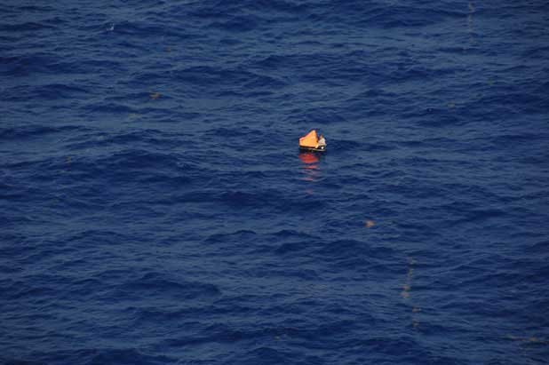 Photo of a life raft adrift at sea