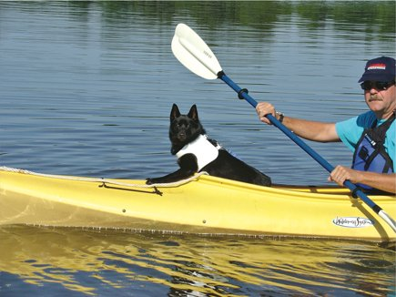 Photo of Randy Thompson kayaking with his dog Skipper