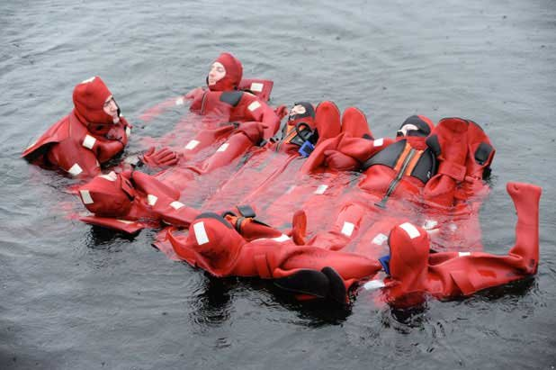 Photo of survivors in water suits waiting for rescue