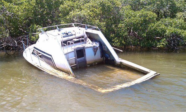 Photo of an abandoned half-sunken boat