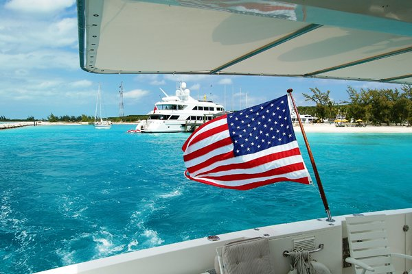 Photo of flying the American flag on boat in the Bahamas