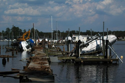 Photo of damage to docks and boats caused by the wind and storm surge