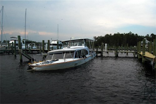 Photo of a wood bottomed boat docked in Whitaker Creek