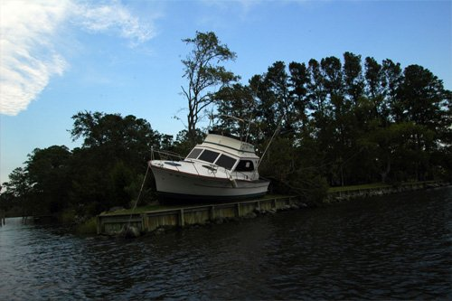 Photo of boat in front yard after storm
