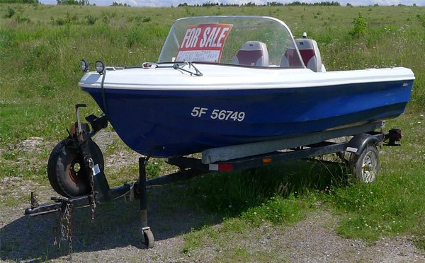 Photo of the bowrider with For Sale Sign