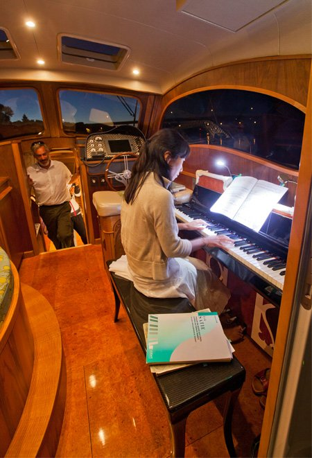 Photo of playing the 42-foot motor yacht, Lionheart's Concerto electric piano
