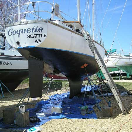 Photo of boat being repainted at a boatyard