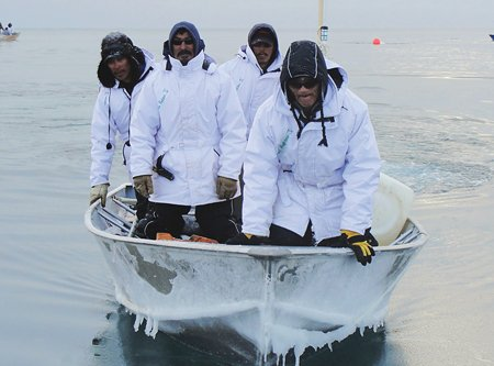 Photo of men on the Chukchi Sea, with all white float coats