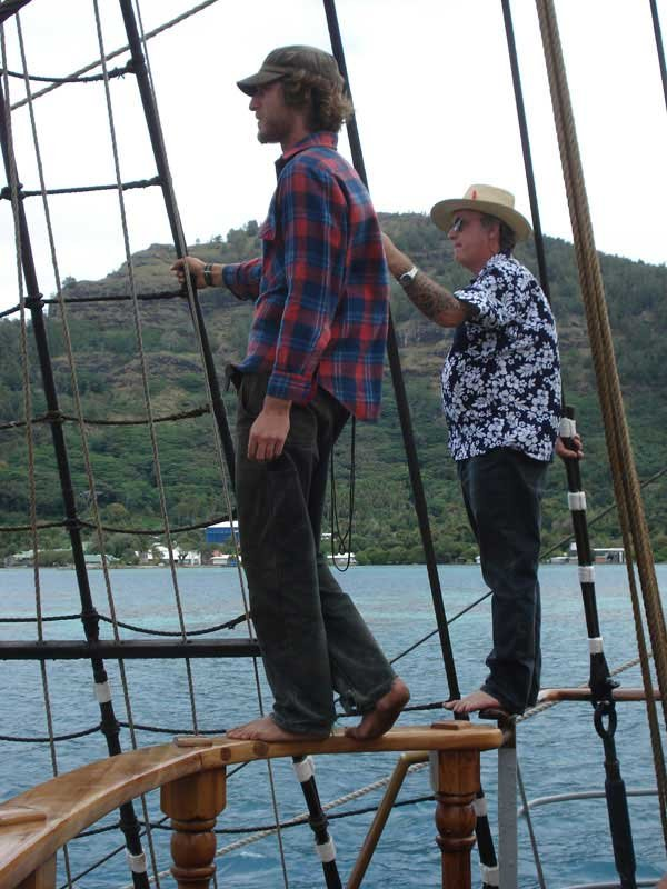 Photo of the Chief Mate and Captain piloting out of the lagoon on the Picton Castle