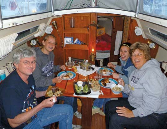 Photo of sharing a meal aboard Dream Catcher during an SJSC weekend cruise