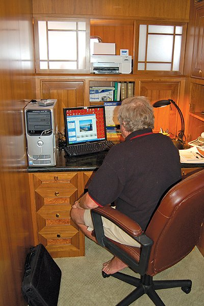 Photo of a dedicated onboard office in a Grande Alaskan was converted from a stateroom