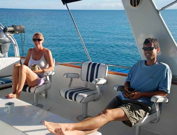 Photo of the Angela and Nick relaxing on the Lady Enna