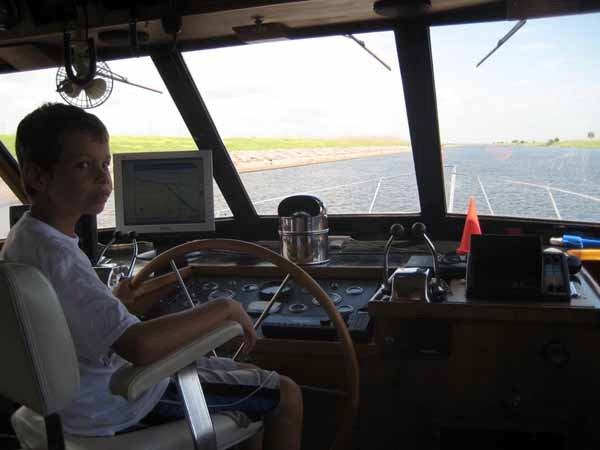 Photo of Nickolas at the helm
