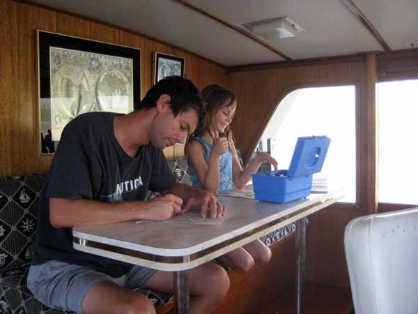 Photo of Nick and Eileen passing the time aboard the Lady Enna
