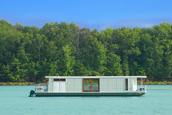 Photo of a houseboat floating on the water