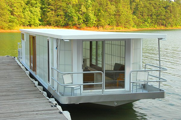 Photo of a houseboat anchored along a dock