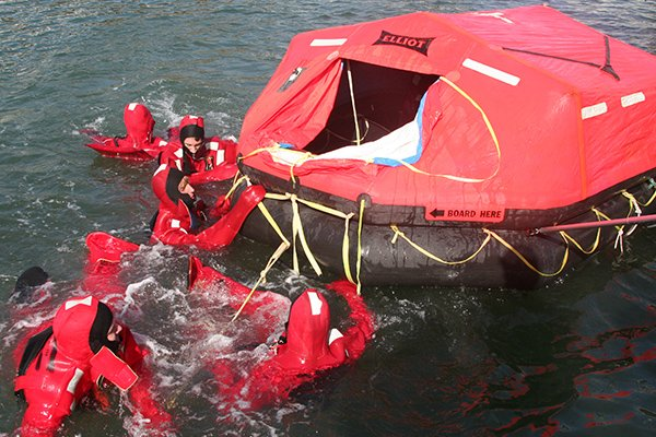 Photo of Scouts performing a liferaft drill