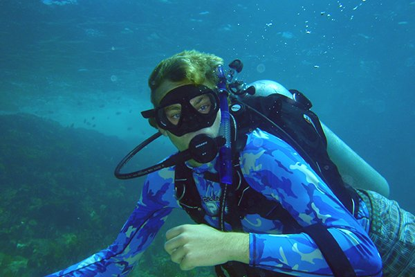Photo of a female Scout scuba diving
