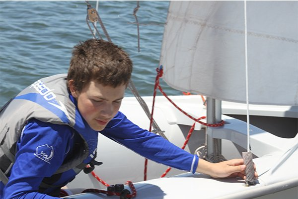 Photo of young Sea Scout learning to sail