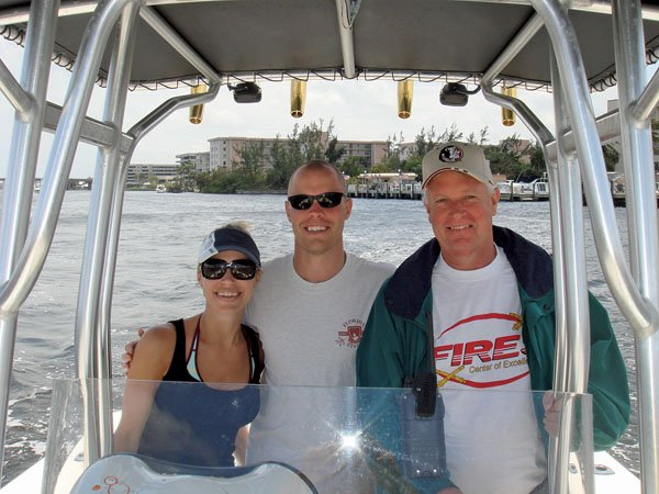Photo of Tom Blair, an aspiring Looper, with his son Philip and daughter Mia aboard her Mako