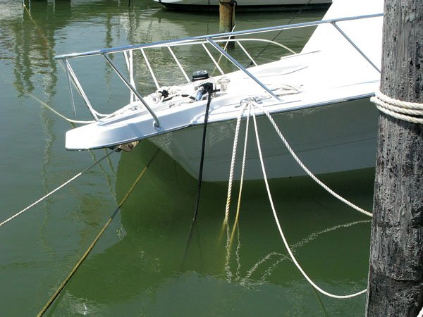 Photo of a boat that sank because the marina's badly corroded piling