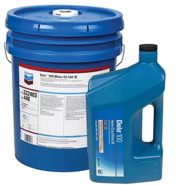 Photo of engine oil drum and bottle