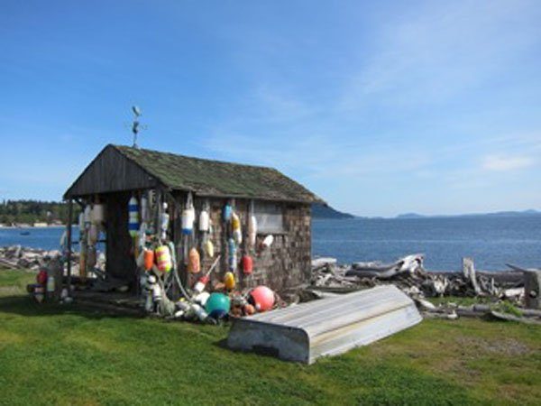 Photo of a fishing shack that dot the Lummi Island shoreline.
