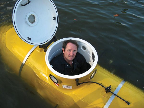 Photo of Mark Ragan in a yellow submarine