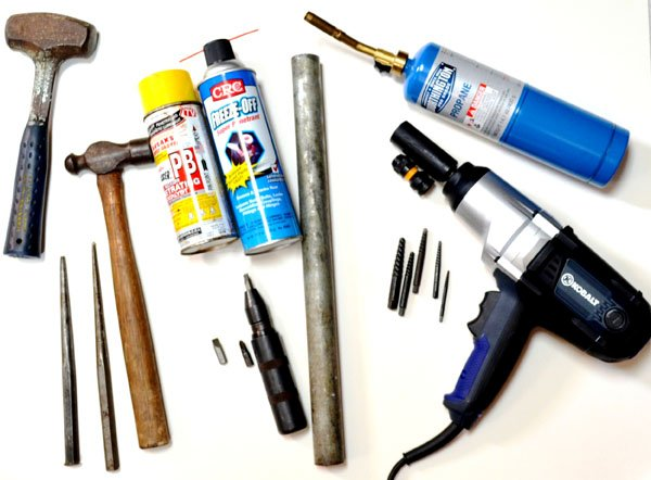 Photo of various tools and lubricates use can use to loose a bolt