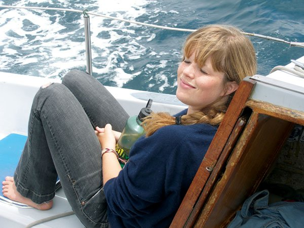 Photo of author's daughter Caity enjoys the sailing breezes
