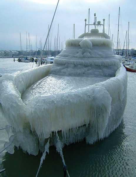 Photo of 30-foot powerboat encased in ice