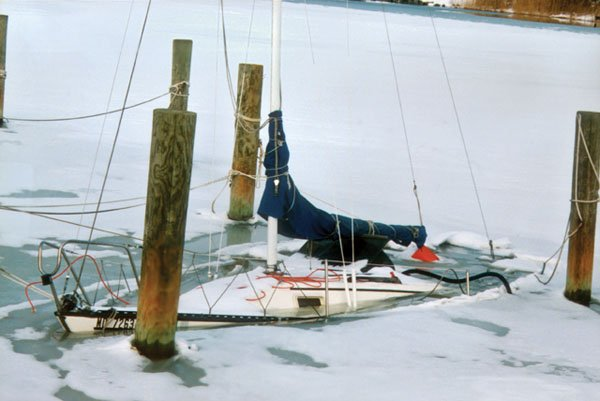 Photo of 22-foot sailboat that sank when its scuppers were shoved below the waterline by the weight of a winter snow
