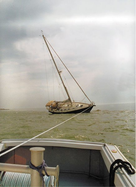Photo of a sailboat run aground being towed